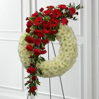 Sympathy wreath with floral tribute