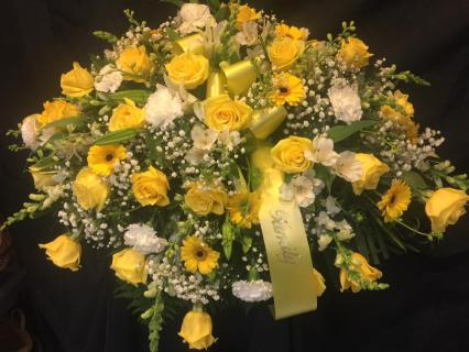 Yellow family casket tribute